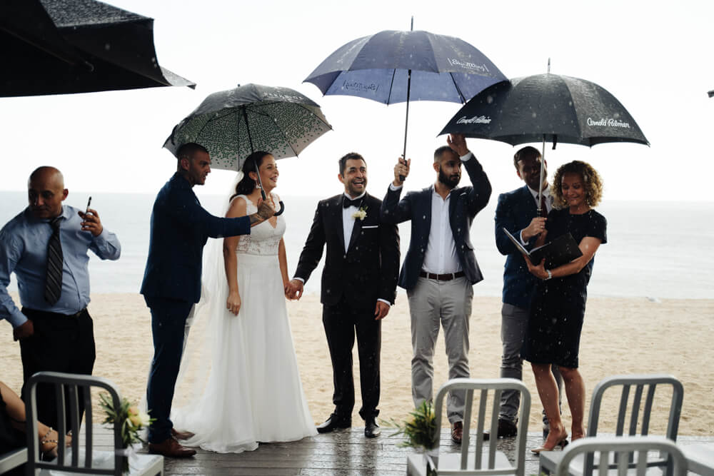 Wedding couple getting married in the rain-rain-on-your-wedding-day