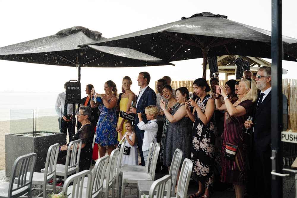 Wedding guests in the rain-rain-on-your-wedding-day