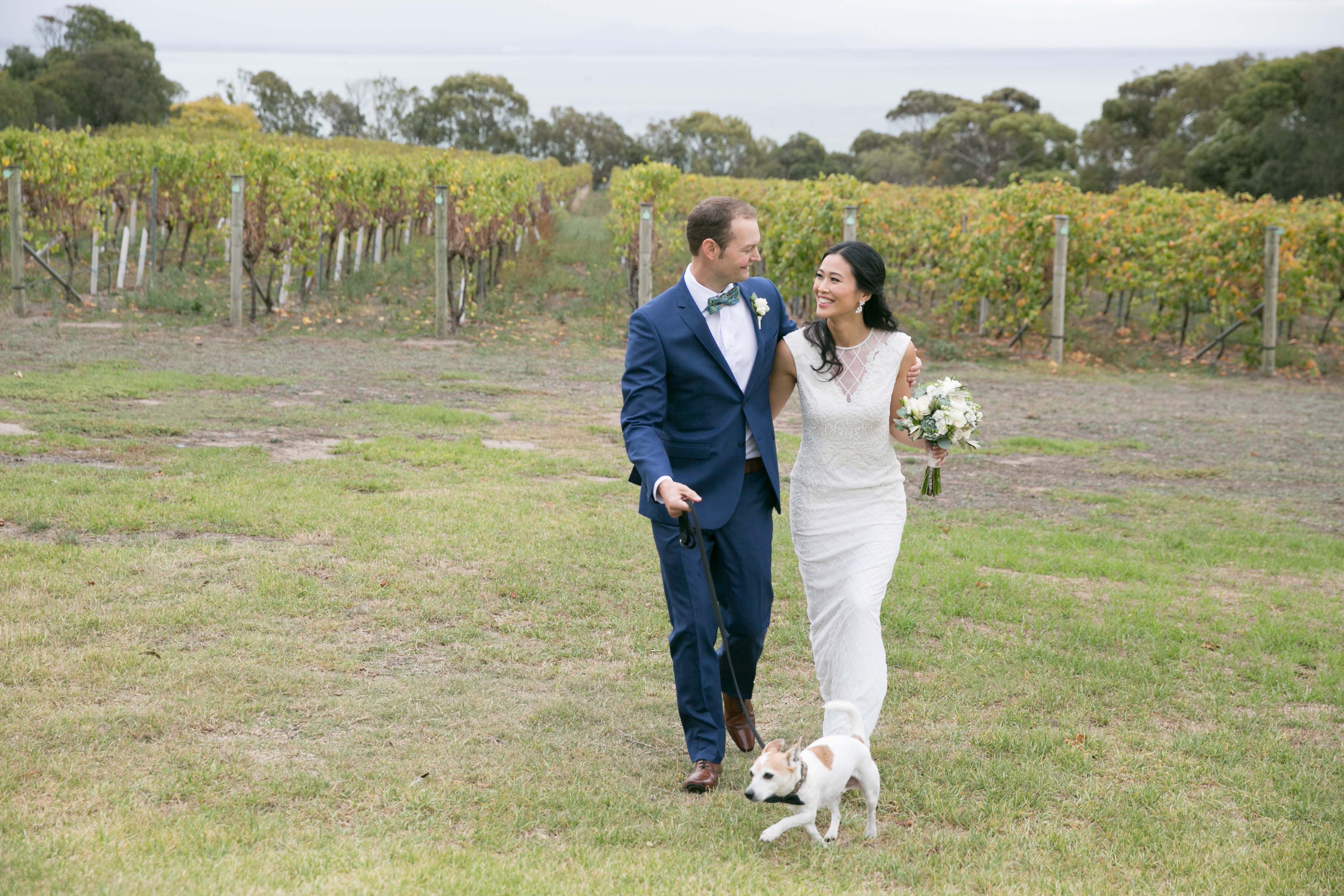 Wedding couple taking their dog for a walk - thinking-of-having-your-dog-at-your-wedding?