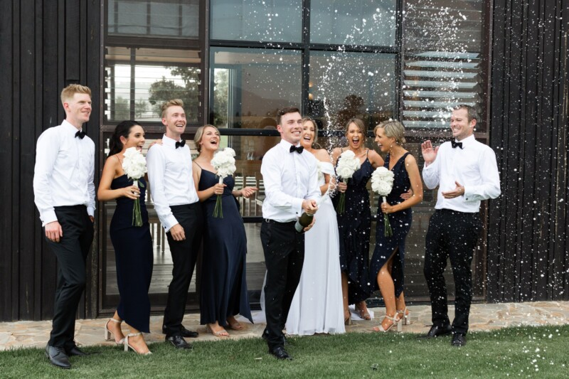 Couple celebrating with champagne at Zonzo Estate-yarra-valley-wedding-venues